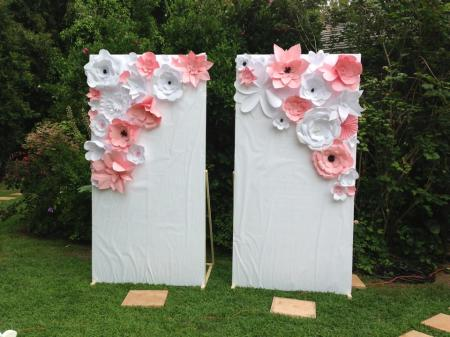 Pink and white paper flower wall panel for photo op